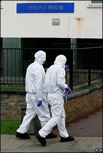 Forensic experts enter the tower in Erith