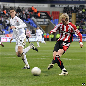 Carney scores the opener at the Reebok Stadium