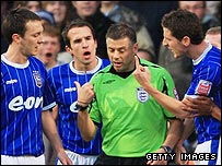Ipswich's players remonstrate with Mark Halsey after Liam Trotter's sending-off