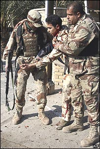 Iraqi soldiers attend an injured colleague after the blast.