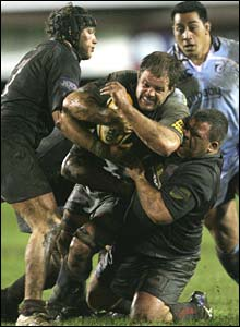 Cardiff Bleus captain Xavier Rush makes a typically strong forward charge in muddy conditions at the Arms Park on Friday night