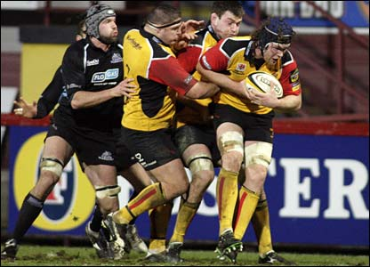 Newport Gwent Dragons lock Andy Hall protects possession against Glasgow in Friday night's Magners League match