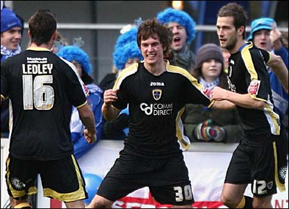 Midfielder Aaron Ramsey celebrates his first career goal for Cardiff City on his full debut