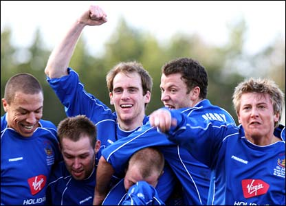 Chasetown celebrate their opener after Cardiff's Kevin McNaughton scores into his own net