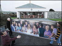 Nicholas St John Rosse (l) shows off his painting with Father Brian Storey (c) his son Alex (r)