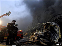 Firefighters work to extinguish a fire at a warehouse in Icheon, South Korea (07/01/2008)