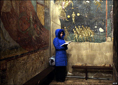 A woman prays in Gracanica Monastery, Kosovo