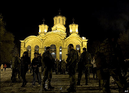 Swedish peacekeepers guard Gracanica Monastery, Kosovo, on the Orthodox Christmas Eve