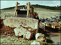 Bulldozer clears ground at Jabal Abu Ghneim site
