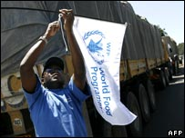 pinning a WFP flag onto a food truck in Nairobi
