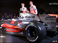 Heikki Kovalainen and Lewis Hamilton by the new McLaren MP4-23 