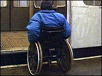 Man in wheelchair trying to get on Tube train