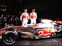 Heikki Kovalainen and Lewis Hamilton pose with the new McLaren MP4-23