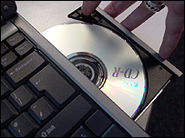 Recordable CD being loaded into a laptop