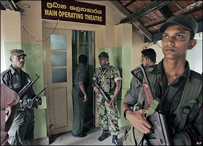 Sri Lankan soldiers stand guard outside an operating room where Mr Dassanayake underwent surgery