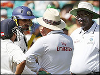 Harbhajan Singh (holding bat) is spoken to by the umpires during the Sydney Test