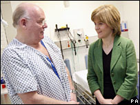 Nicola Sturgeon talking with a patient