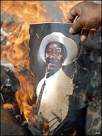 Indian protestors burn a picture of umpire Steve Bucknor