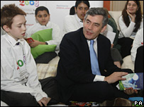 Gordon Brown reads with some children