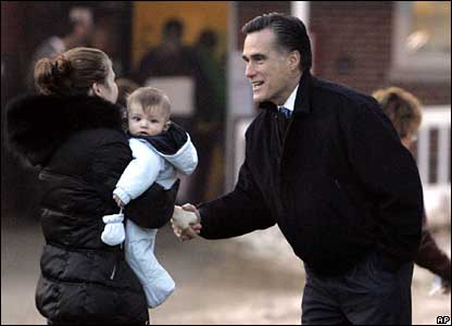 Mitt Romney greets a voter during Tuesday's presidential primary.