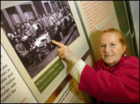 Ann Teear with an old picture of herself