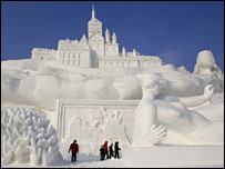 Tourists visit a snow sculpture on display at the annual Ice and Snow Festival in Harbin, China (January 2008)