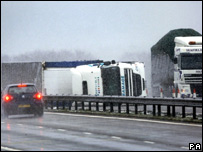 Overturned lorry on M74