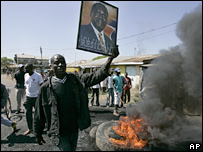 Raila Odinga supporters with burning tyre 09/01/08