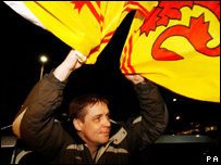Richey hold lion rampant outside airport