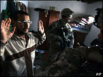 US soldiers interrogate a suspect in Diyala, 8 January 2008