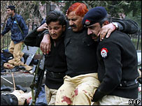 A wounded police officer at the scene of a bombing in Lahore, Pakistan, on 10 January 2008
