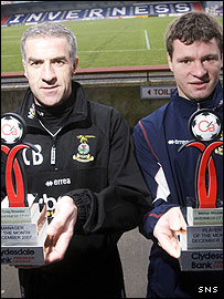 Craig Brewster (left) and Marius Niculae show off their awards