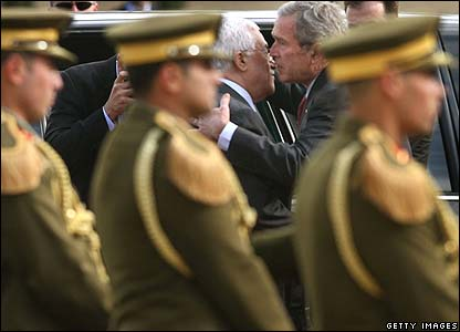 President Bush kisses Mahmoud Abbas goodbye