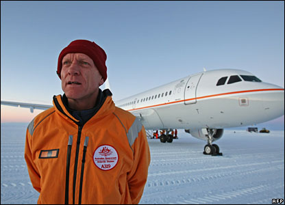 Australian Environment Minister Peter Garrett in front of the plane on the runway