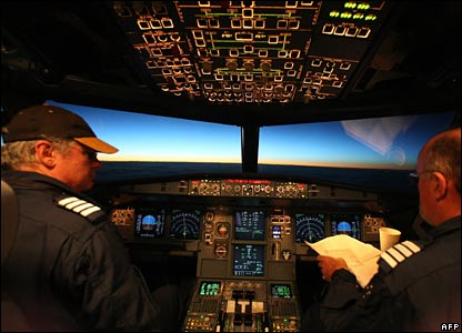 Two pilots in the cockpit of the plane as it flies into the midnight sun.