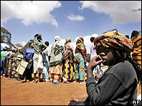 People queue  for aid in the Kibera slum, Nairobi, on 11 January