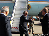 George Bush waves goodbye to President Shimon Peres (l) and Prime Minister Ehud Olmert as he leaves Israel, 11 January 2008