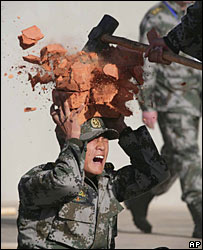 A Chinese soldier practises during joint exercises with Indian troops
