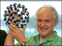 Harry Kroto with a model of C60 (PA)