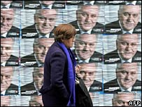 A woman walks past election posters in Belgrade. File photo