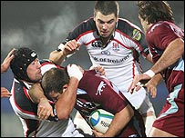 Ulster's Justin Fitzpatrick tackles Arnaud Tchougong of Bourgoin