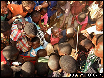 Displaced children from the Kibera slum in Nairobi scramble for food aid
