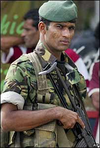 Sri Lankan soldier stands guard on a street in Colombo