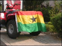 A Ghana flag on a quadbike