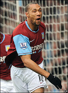 Aston Villa's John Carew celebrates