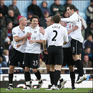 Simon Davies is mobbed by his Fulham team-mates