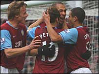 Aston Villa celebrate John Carew's first-half strike