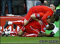 Middlesbrough captain George Boateng (bottom) celebrates his goal against Liverpool