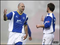 Jim Thomson (left) celebrates after doubling Queen Of The South's advantage