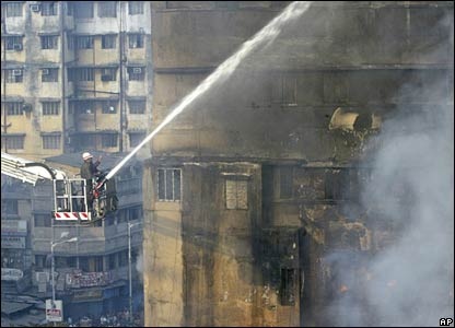 Firefighters work to extinguish a fire in Calcutta